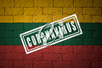 Flag of the Lithuania with original proportions. stamped of Coronavirus. brick wall texture. Corona virus concept. On the verge of a COVID-19 or 2019-nCoV Pandemic.