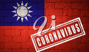 Flag of the Taiwan with original proportions. stamped of Coronavirus. brick wall texture. Corona virus concept. On the verge of a COVID-19 or 2019-nCoV Pandemic.