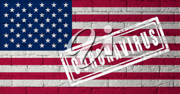 Flag of the United States with original proportions. stamped of Coronavirus. brick wall texture. Corona virus concept. On the verge of a COVID-19 or 2019-nCoV Pandemic.