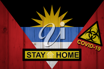 Flag of the Antigua and Barbuda in original proportions. Quarantine and isolation - Stay at home. flag with biohazard symbol and inscription COVID-19.