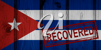 flag of Cuba that survived or recovered from the infections of corona virus epidemic or coronavirus. Grunge flag with stamp Recovered