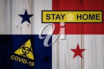 Flag of the Panama in original proportions. Quarantine and isolation - Stay at home. flag with biohazard symbol and inscription COVID-19.